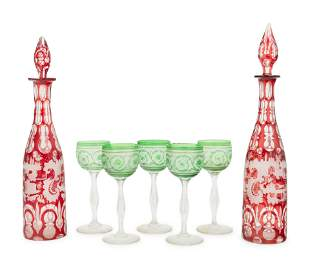 A Pair of Bohemian Glass Decanters with Five Associated
