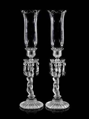 A Pair of Baccarat Glass Figural Candlesticks