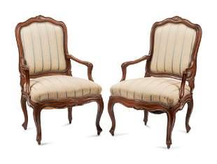A Pair of Louis XV Walnut Fauteuils