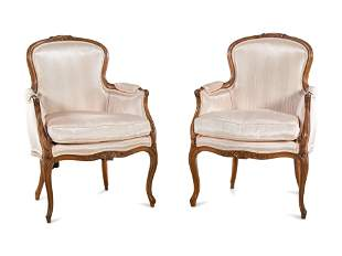 A Pair of Louis XV Style Walnut Bergeres