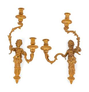 A Pair of Louis XV Style Gilt Bronze Figural Two-Light