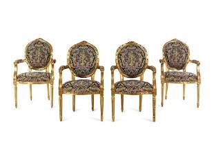 A Set of Four Louis XVI Style Giltwood Fauteuils