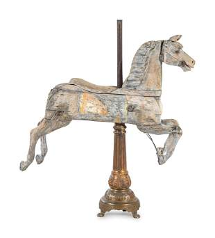 A Carved Pine Horse Form Carousel Figure