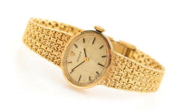 5: A 14 Karat Yellow Gold Wristwatch, Rolex,