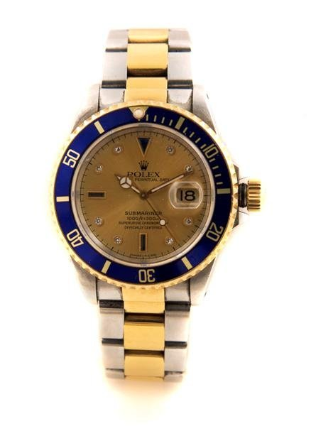 10: An 18 Karat Yellow Gold and Stainless Steel Oyster
