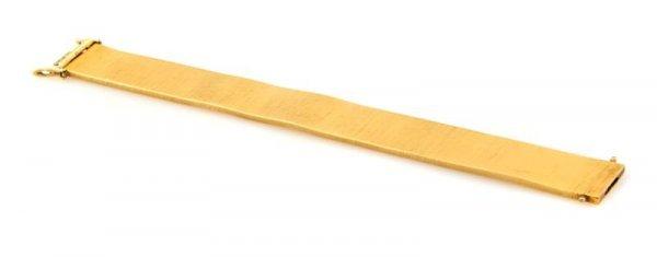 317: An 18 Karat Yellow Gold Textured Bracelet, 48.20 d