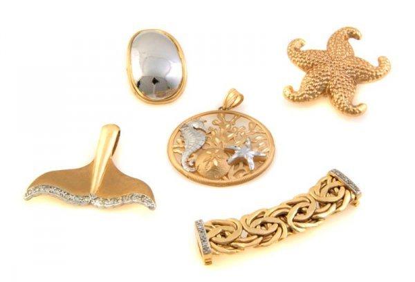 329: A Group of 14 Karat Gold and Diamond Pendants, 21.