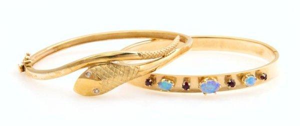 330: A Pair of 14 Karat Yellow Gold Hinged Bangle Brace