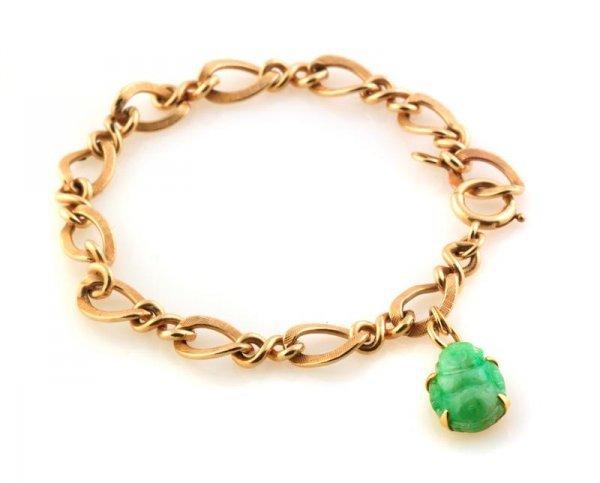 339: A 14 Karat Yellow Gold Link Bracelet with a 22 Kar