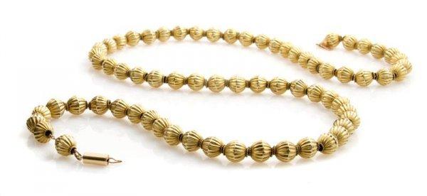 344A: A 14 Karat Yellow Gold Bead Necklace.