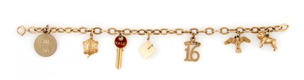 345: A 14 Karat Yellow Gold Charm Bracelet, 12.95 dwts.