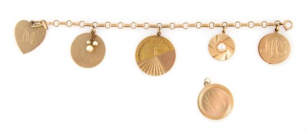 346: A 14 Karat Yellow Gold Charm Bracelet, 21.45 dwts.