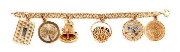 349: A 14 Karat Yellow Gold Charm Bracelet, 32.13 dwts.