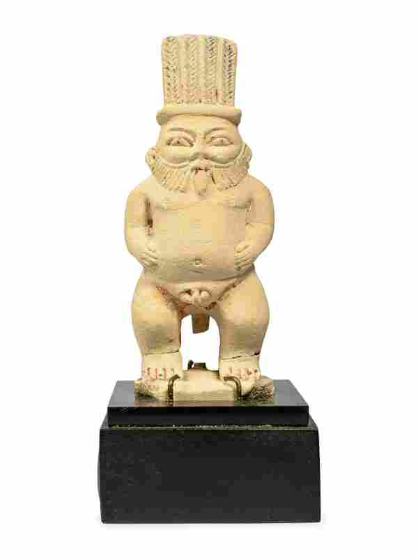 An Egyptian Painted Limestone Bes Height 5 inches.