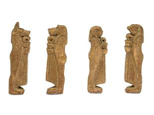 Four Egyptian Faience Amulets Height of each 3 1/4