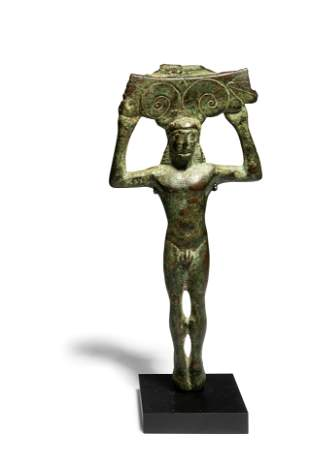 A Greek Bronze Patera Handle, in the shape of a Kouros