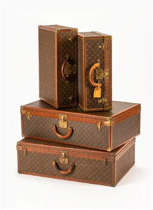 A Group of Four Louis Vuitton Hard-Sided Suitcases