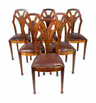 A Set of Six Art Deco Carved Walnut Dining Chairs