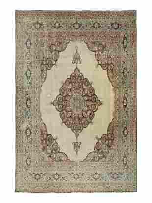 A Tabriz Wool Rug