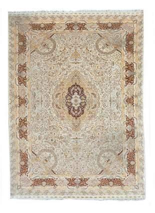 A Tabriz Silk Rug 13 feet 9 inches x 10 feet 2 inches.