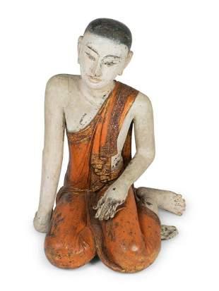 A Thai Polychromed Figure of a Seated Figure Height 35