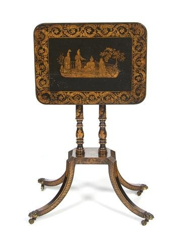 15: An English Ebonized Tilt-Top Table, Height 28 x wid