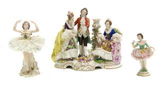 396 A Dresden Porcelain Figural Group Height of first