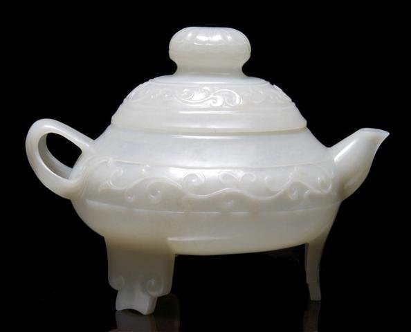 642: A Chinese Translucent Carved Jade Teapot, Width 7