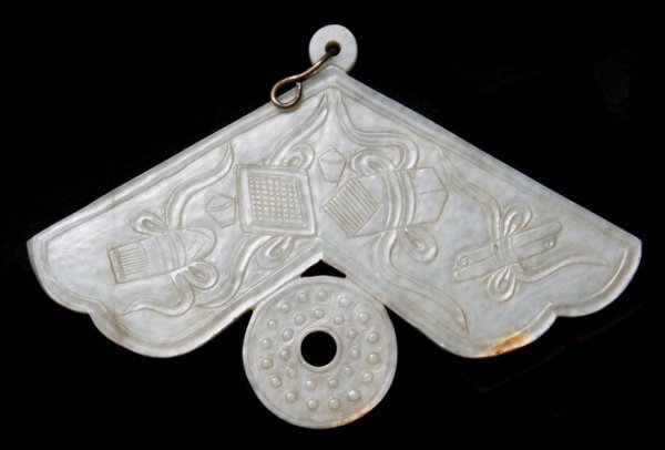 650: A Jade Chime Form Plaque, Width 7 inches.