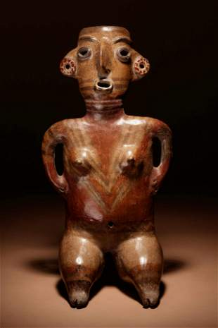 A Zacatecas Painted Terracotta Seated Female Height 15