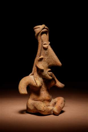 A Jalisco Terracotta Seated Figure Height 5 inches.