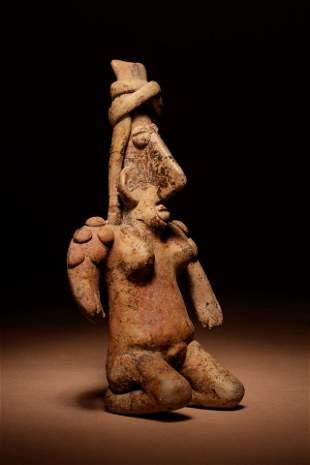 A Jalisco Terracotta Kneeling Figure Height 5 3/4