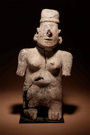 A Nayarit Terracotta Standing Figure Height 21 inches.