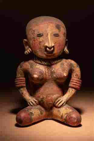 A Nayarit Terracotta Seated Female Figure Height 13 1/4