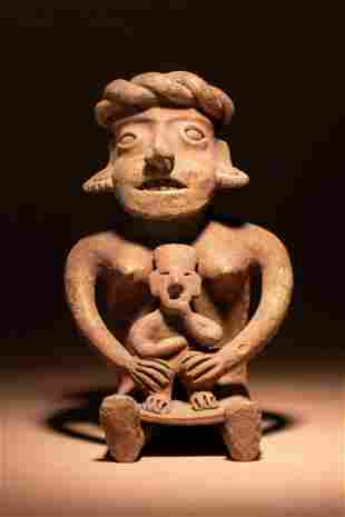 A Colima Terracotta Seated Mother and Child Figure