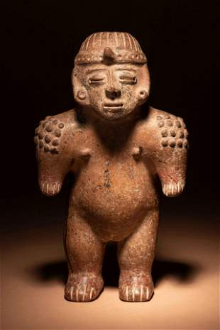 A Jalisco Terracotta Standing Male Figure Height 12