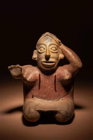 A Jalisco Terracotta Seated Figures Height of taller 10