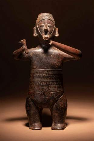 A Colima Terracotta Standing Male Figure with Incised