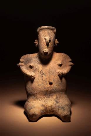 A Nayarit Terracotta Seated Female Figure Height 10 3/4