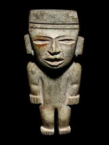 A Teotihuacan Greenstone Figure Height 8 1/2 inches.