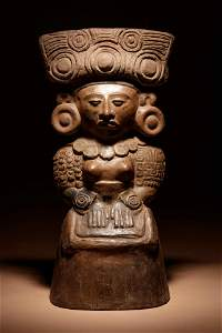 A Maya Molded Female Personage Height 18 inches.