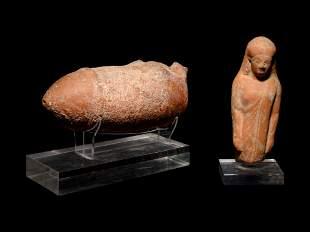 A Greek Terracotta Oil Lamp and a Kore