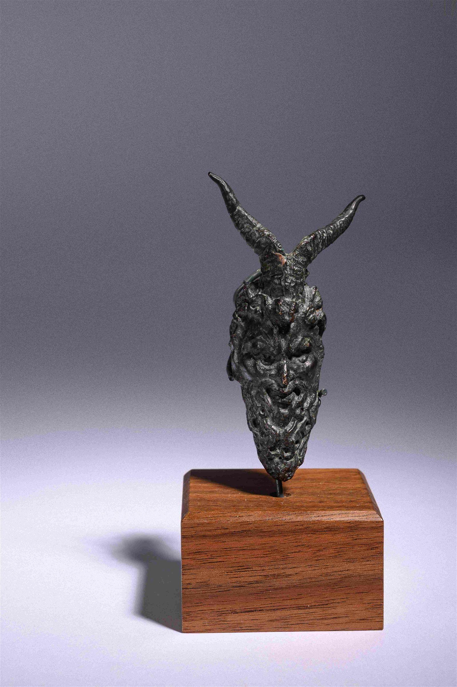 A Roman Bronze Satyr Head Applique Height 3 1/3 inches.