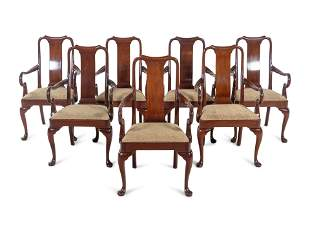 A Set of Seven Queen Anne Style Mahogany Dining Chairs