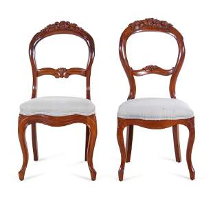 A Pair of Victorian Carved Walnut Side Chairs