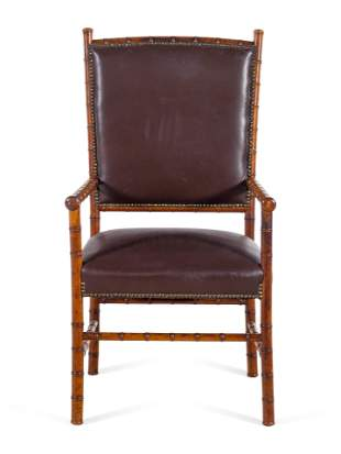 A Leather Upholstered Faux Bamboo Armchair