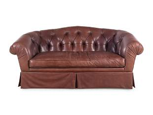 A Leather Upholstered Chesterfield Sofa