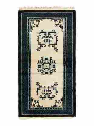 A Chinese Blue and White Wool Runner