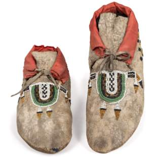 Crow Beaded Buffalo Hide Moccasins length 9 1/4 inches
