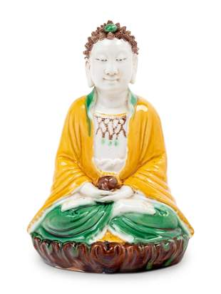 A Chinese Sancai Glazed Biscuit Figure of Buddha